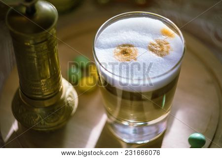 Coffee Latte Macchiato Cup With A Coffee Grinder And Colorful Sweets On The Wooden Board
