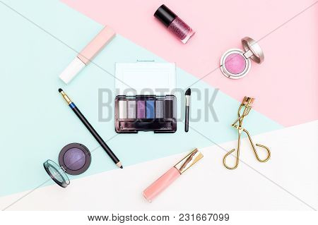 Cosmetics And Accessories On Pastel Color Background. Flat Lay