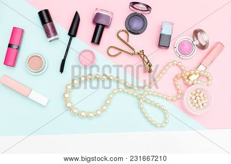 Makeup Tools And Pearl Beads On Pastel Background. Flat Lay