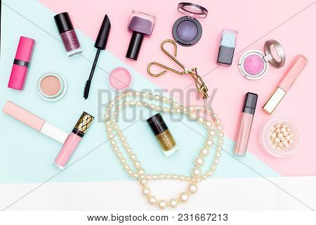 Set Of Professional Decorative Cosmetics And Earl Beads On Pastel  Background. Flat Lay