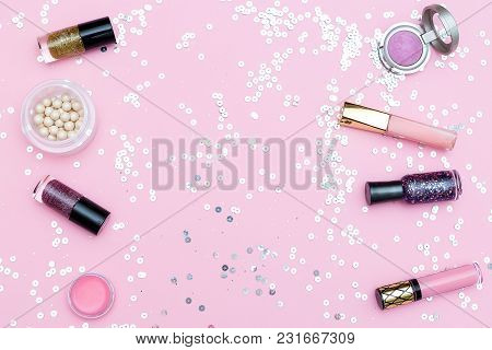 Decorative Cosmetics. On Pink Background With Sparkles. Copy Space