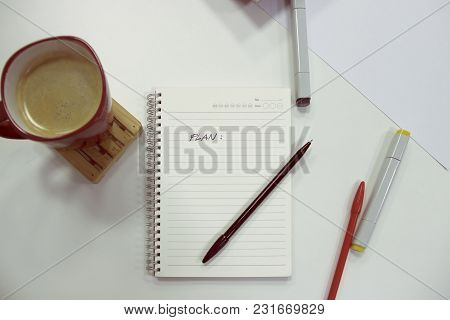 Workplace Table Photo Of A Notepad With Full Coffee Cup, Stationary For A Brainstorm/work-in-progres
