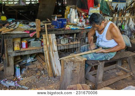 Lampang, Thailand - November 2, 2012: Carpenter Polishing Wooden Handle Of Sword  To Make Sword In T