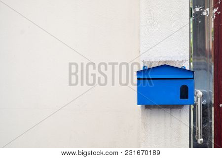 Blue Post Office Boxes Installed At The Front Of The House For Receiving Mail