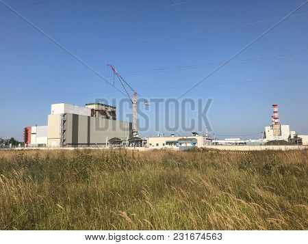 View Of Nuclear Power Plant. Nuclear Power Plant Located In The Town Of Desnogorsk. In The Foregroun
