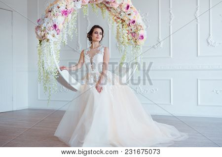 Beautiful Young Woman With Stylish Brunette Hair And Elegant Dress Posing In Luxury White Classic Ro