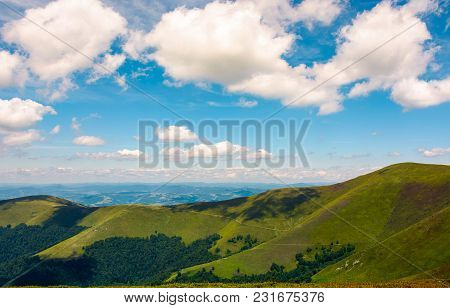 Beautiful Landscape Of Carpathian Mountains. Grassy Hills Of Borzhava Ridge Under The Blue Sky With