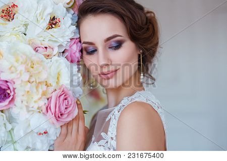 Beautiful Romantic Young Woman In Elegant Dress Posing On A Background Of Flowers. Inspiration Of Sp
