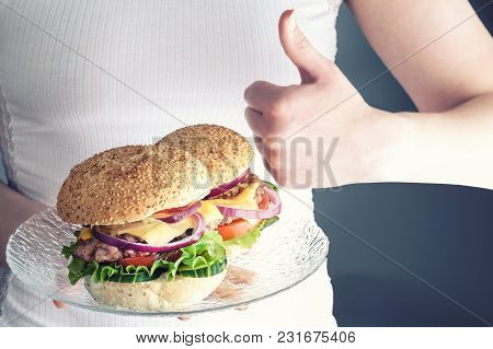 Girl Holding A Plate Of Burgers. The Girl Holds A Glass Plate With Delicious Burgers In One Hand, Wi