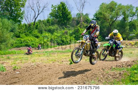 Uzhgorod, Ukraine - May 21, 2017: Extreme Enduro Moto Sport. Ktm Racers Turn On A Corner In Dirt. Tr