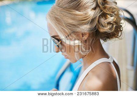 Portrait Of Beautiful And Fashionable Blonde Model Girl, In Sunglasses And Bikini.