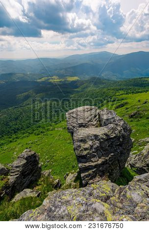Giant Boulder On A Cliff Over The Grassy Hillside. Beautiful Summer Landscape In Carpathian Mountain
