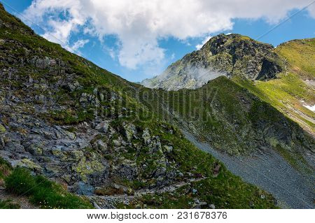 Peaks Of Mountain Ridge Among The Clouds. Mighty Formations With Rocky Tops And Grassy Hills. Beauti