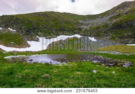 Little Swamp Under The Hill With Patch Of Snow. Lovely Springtime Nature Background