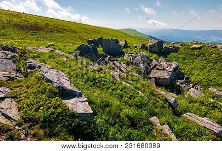 Mountain Summer Landscape. Meadow With Huge Rocks Among The Grass On Top Of The Hillside Near The Pe