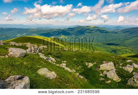 Green Rolling Hills Of Carpathian Mountains. Beautiful Summer Landscape Under Blue Sky With Some Clo