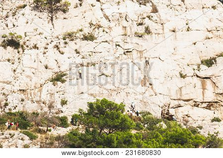 Unidentified People Climbing White Cliffs Of Massif Des Calanques In Cassis, France