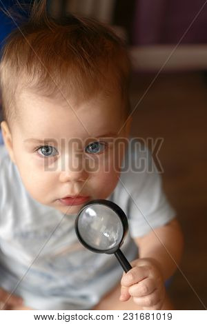 A Child Sitting On A Piss-pot Holds A Magnifying Glass In His Hands. Cognition Of The World Around U