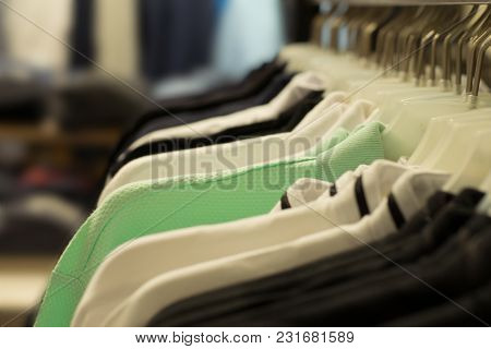 Neutral Colors Of Clothes. A Variety Of Hangers With Clothes