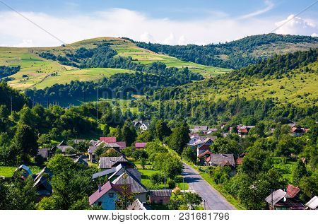 Road Through Village In Carpathian Mountains. Bird Eye View Of Beautiful Rural Scenery In Summertime