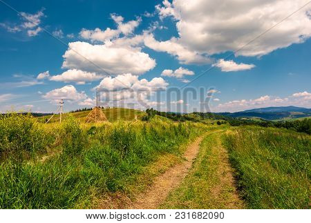 Country Road Along The Hillside. Lovely Countryside Rural Scenery In Summer. Beautiful Blue Summer S