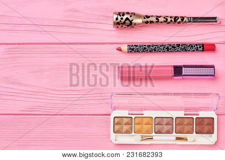 Make Up Cosmetics Set And Copy Space. Brown Eyeshadows Palette, Lipstick, Pencil For Lips And Eyelin