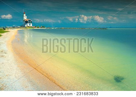 Majestic Lighthouse On The Island Of Marken And Stunning Beach With Sand, Netherland, Europe