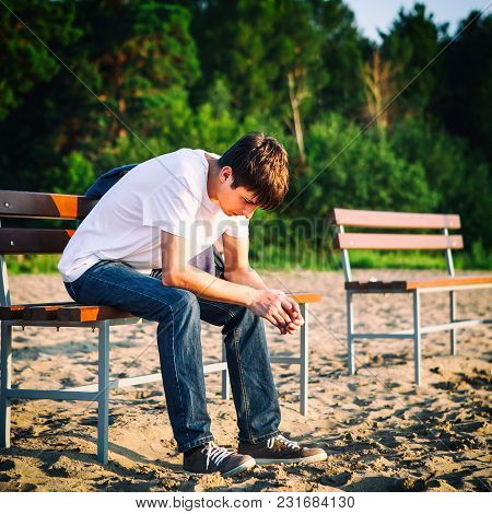 Sad Guy Sit On The Bench Outdoor