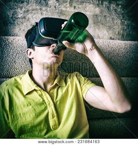 Toned Photo Of Young Man In Vr Glasses Drink A Beer