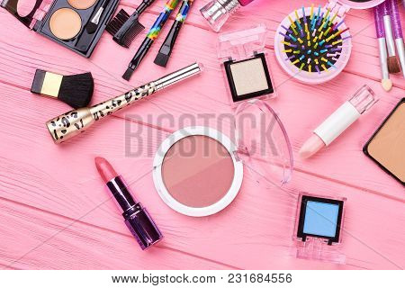 Cosmetics And Tools On Pink Background. Blush Powder, Lipstick, Eyeshadows And Different Cosmetics A