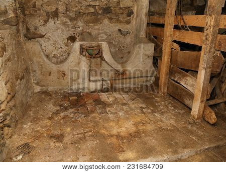 Interior Of An Old Barn With An Abandoned Marble Manger