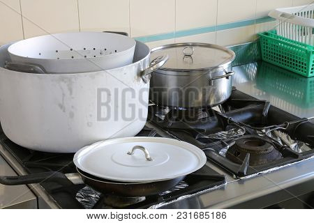Many Pots In The Industrial Kitchen During Meal Preparation