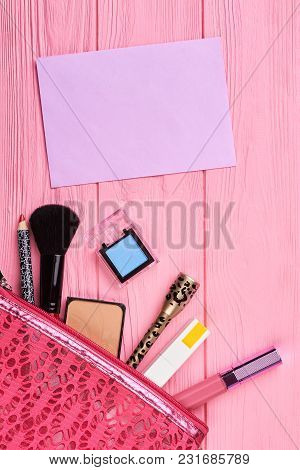 Flat Lay Cosmetics On Pink Wooden Background. Different Make Up Beauty Care Essentials Cosmetics, Bl