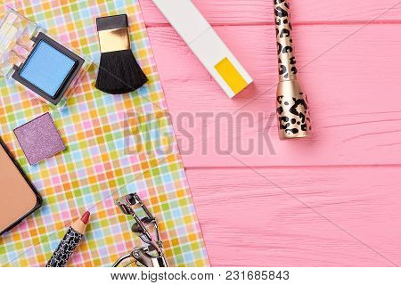 Feminine Cosmetics Background, Top View. Woman Makeup Accessories And Tools On Colorful Background W
