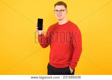 Caucasian Confident Smart Elegant Young Man In Sweater Standing In Office Looking In Camera