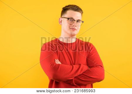 Caucasian Confident Smart Elegant Young Man In Sweater Standing In Office Looking In Camera Waiting
