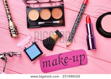 Decorative Cosmetics Set Of Modern Woman. Color Lipstick Palette On Color Background. Flat Lay Beaut