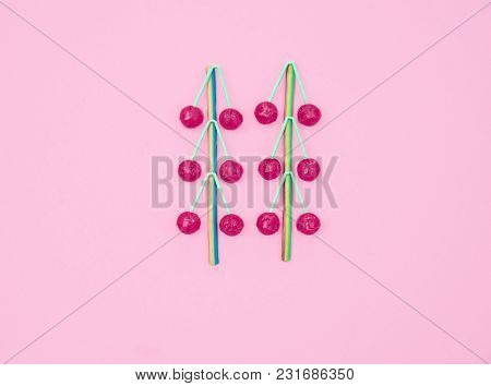 Assorted Colored Lollipops As A Cherry Tree On Pink Background. Flat Lay, Top View.
