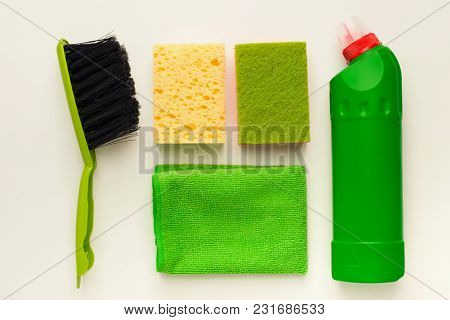 Set Of Green House Cleaning Products And Supplies On White Isolated Background, Top View. Spring Cle