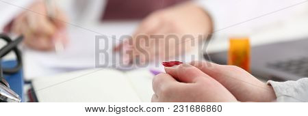 Female Doctor Hand Hold Silver Pen Filling Patient History List At Clipboard Pad. Physical Exam Er D
