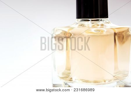 Glass Bottle Of Perfume On A Light Background
