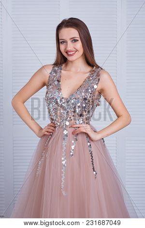 Elegant Sensual Young Woman In Beautiful Dress Posing Indoor