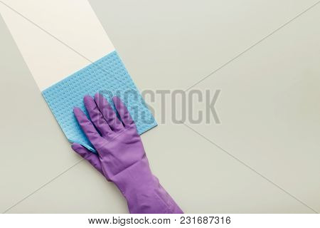 Hand In Protective Rubber Glove With Blue Rag. Woman Washing White Surface With Micro Fiber Cloth, B