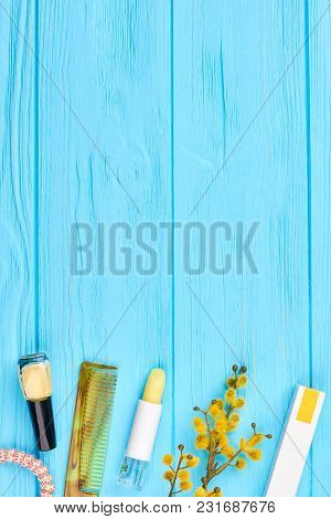 Flat Lay Cosmetics On Blue Background. Cosmetics, Accessories And Pussy Willow Twig On Wooden Backgr