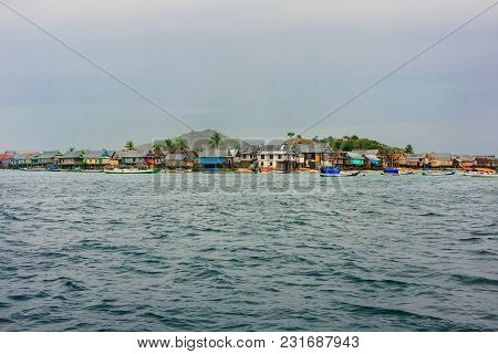 Small Island With Typical Village In Komodo National Park, Nusa Tenggara, Indonesia. Komodo National