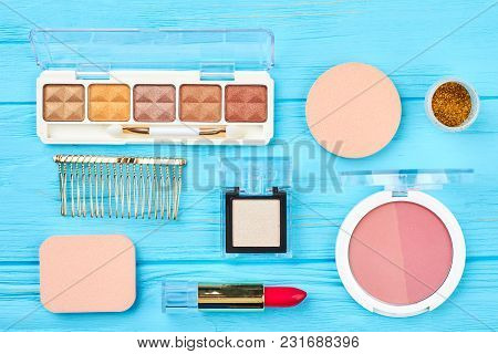 Decorative Cosmetics Set, Top View. Make Up Cosmetics Fashion Items On Blue Wooden Background. Glamo