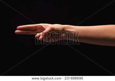 Female Hand Showing Two Fingers, Number Two Isolated At Black Background. Counting, Gesturing, Enume