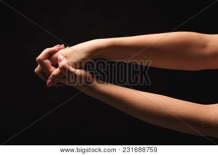Clasped Female Hands On Black Isolated Studio Background, Low Key, Copy Space, Cutout