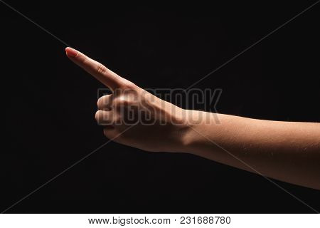 Female Hand, Forefinger Pointing Away. Hand Gestures - Woman Indicating On Virtual Object With Index