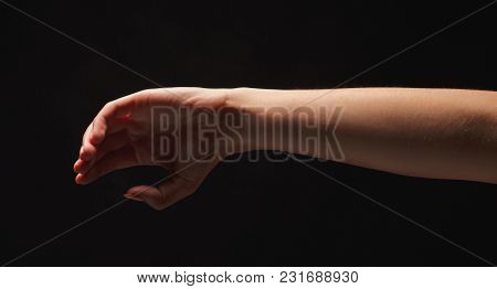 Woman Showing Defending Gesture At Black Isolated Background, Low Key, Cutout, Copy Space
